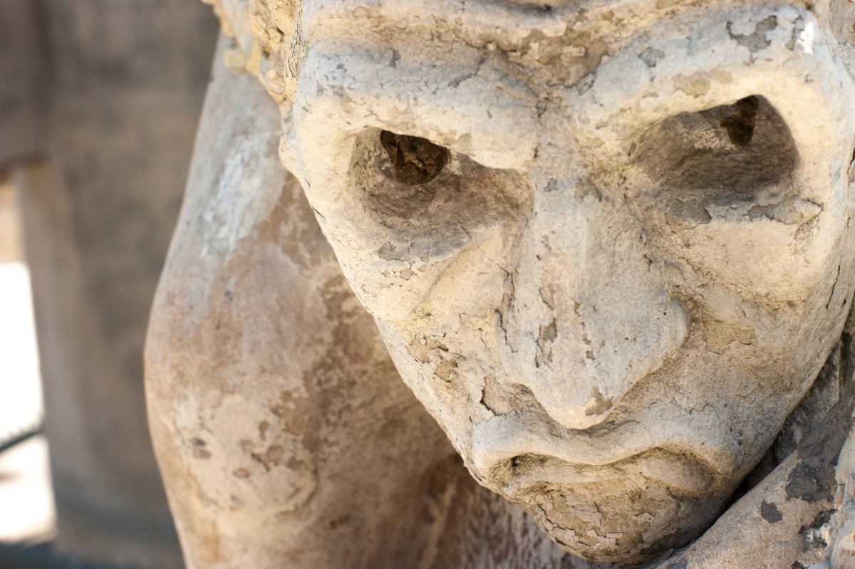 stone faced statue close-up